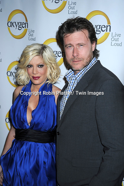 Tori Spelling and Dean McDermott attending the Oxygen Upfront on April 4, 2011 at Gotham Hall in New York City.