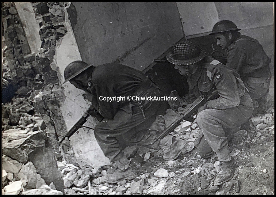 BNPS.co.uk (01202 558833)<br /> Pic:  ChiswickAuctions/BNPS<br /> <br /> Tommies taking cover during the Italian campaign at Monte Cassino.<br /> <br /> Remarkable previously unseen photos documenting the momentous closing stages of World War Two and its historic aftermath have come to light.<br /> <br /> They were taken by Sergeant Charles Hewitt, of the Army Film and Photographic Unit, who later went on to work for the Picture Post and the BBC.<br /> <br /> He was present at many of the important offensives of 1944 and '45 including the Battle of Monte Cassino during the Italian Campaign and the Allies advance into Germany following the D-Day invasion.