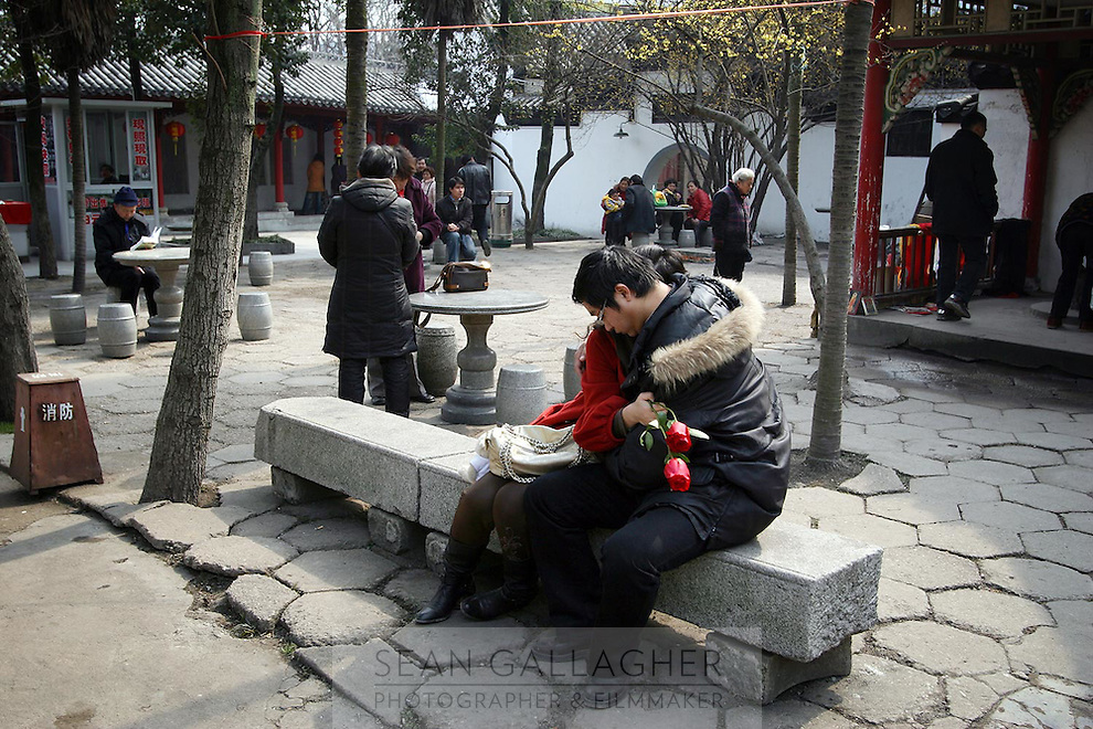 A couple embrace in the grounds of Guiyuan Temple in Wuhan, central China.<br />