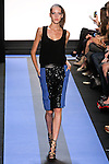 kris walks runway in a carbon black crepe racer tank with lace back, and cyan blue crepe pencil skirt with sequin front, by Monique Lhuillier, from the Monique Lhuillier Spring 2012 collection fashion show, during Mercedes-Benz Fashion Week Spring 2012.