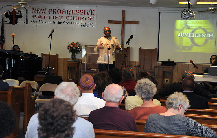 Rev G. Modele Clarke, delivering a welcome at the start of Kingston's 2nd Juneteenth Celebration, sponsored by the Kingston Chapter of ENJAN (End the New Jim Crow Action Network) and New Progressive Baptist Church, and held at the church in Kingston on Saturday, June 14, 2014. Photo by Jim Peppler. Copyright Jim Peppler 2014 all rights reserved.