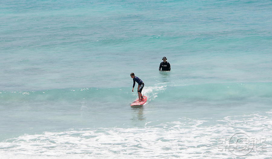 Josh , learning to surf at Freights, nr Oistens , South Coast ..Barbados , Easter 2010 ..pic copyright Steve Behr / Stockfile