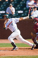 Harold Martinez #9 of the Miami Hurricanes follows through on his swing against the Florida State Seminoles at the 2010 ACC Baseball Tournament at NewBridge Bank Park May 26, 2010, in Greensboro, North Carolina.  The Hurricanes defeated the Seminoles 9-3.  Photo by Brian Westerholt / Four Seam Images