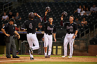 ASU Sun Devils Hunter Bishop (4) is congratulated by Sam Ferri (9) and Spencer Torkelson (20) after hitting a home run during an Instructional League game against the Texas Rangers at Surprise Stadium on October 6, 2018 in Surprise, Arizona. (Zachary Lucy/Four Seam Images)