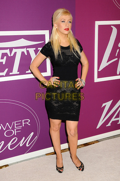 """CHRISTINA AGUILERA.Variety's 1st Annual """"Power Of Women"""" Luncheon held at the Beverly Wilshire hotel, Beverly Hills, California, USA..September 24th, 2009.full black fringe sweater jumper knitted dress tattoo lace peep toe Christian Louboutin shoes bracelets hands on hips silver bracelets black.CAP/ADM/BP.©Byron Purvis/AdMedia/Capital Pictures."""