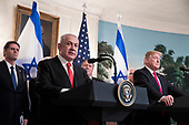 Prime Minister of Israel Benjamin Netanyahu (Front L) delivers remarks beside US President Donald J. Trump (Front R) before Trump signed an order recognizing Golan Heights as Israeli territory, in the Diplomatic Reception Room of the White House in Washington, DC, USA, 25 March 2019.<br /> Credit: Michael Reynolds / Pool via CNP