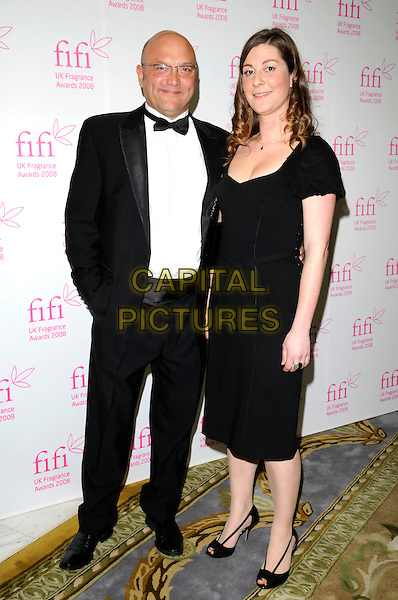 GREGG WALLACE & GUEST.The FIFI UK Fragrance Awards 2008 at the Dorchester Hotel, Park Lane, London, England..April 23rd 2008.full length hand in pocket tuxedo black dress .CAP/CAN.©Can Nguyen/Capital Pictures.