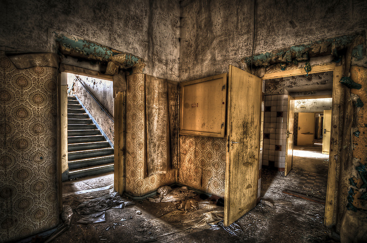 Abandoned lunatic asylum north of Berlin, Germany. Room with open door.