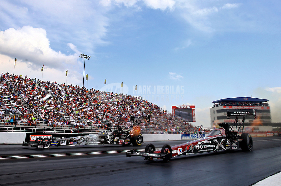 Aug. 31, 2013; Clermont, IN, USA: NHRA top fuel dragster driver Spencer Massey (near) races alongside Bob Vandergriff Jr during qualifying for the US Nationals at Lucas Oil Raceway. Mandatory Credit: Mark J. Rebilas-