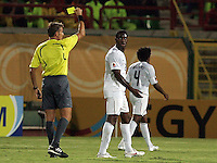 The United States' Gale Agbossoumonde (2) eyes the referee as he is given a yellow card during play against South Korea during the FIFA Under 20 World Cup Group C match between the United States and South Korea at the Mubarak Stadium on October 02, 2009 in Suez, Egypt. The US team lost 3-0.