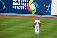 21 March 2009: #53 Bobby Abreu of Venezuela is seen after he drops the ball allowing #8 Keun-Woo Jeong Korea to reach first base in the first inning during the 2009 World Baseball Classic semifinal game at Dodger Stadium in Los Angeles, California, USA. Korea wins 10-2 over Venezuela.