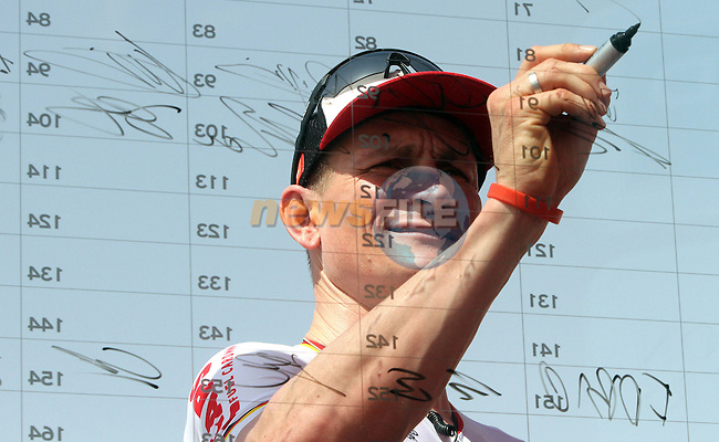 Andre Greipel (GER) Lotto-Soudal signs on before the start of Stage 1 Emirates Motor Company Stage of the 2017 Abu Dhabi Tour, running 189km from Madinat Zayed through the desert and back to Madinat Zayed, Abu Dhabi. 23rd February 2017<br /> Picture: ANSA/Matteo Bazzi | Newsfile<br /> <br /> <br /> All photos usage must carry mandatory copyright credit (&copy; Newsfile | ANSA)