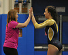 Bethpage gymnastics at Long Beach High School Monday, January 4, 2016. Gabby Castles - Floor, with coach Kim Rhatigan