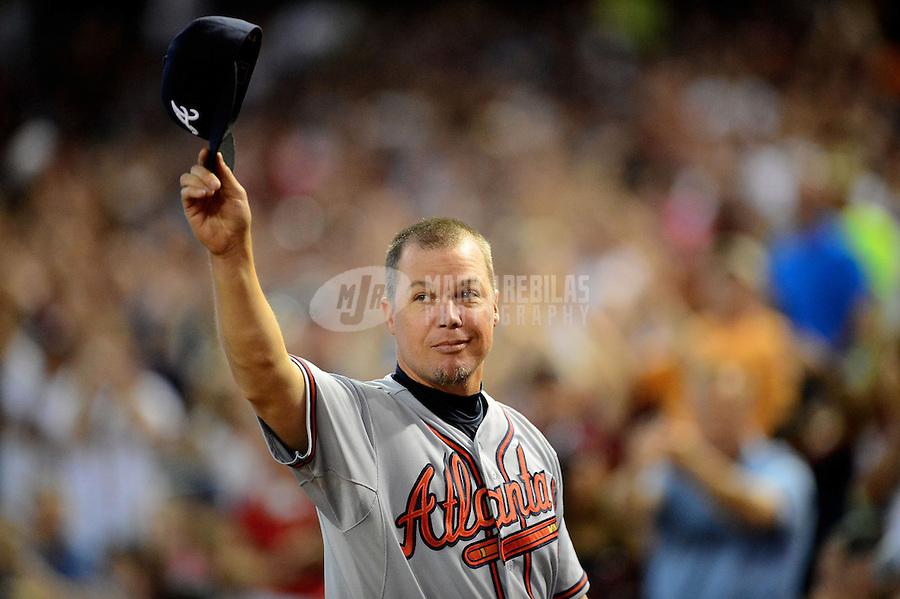 Apr. 22, 2012; Phoenix, AZ, USA; Atlanta Braves third baseman Chipper Jones acknowledges the crowd during his last regular season game at Chase Field against the Arizona Diamondbacks.  Mandatory Credit: Mark J. Rebilas-