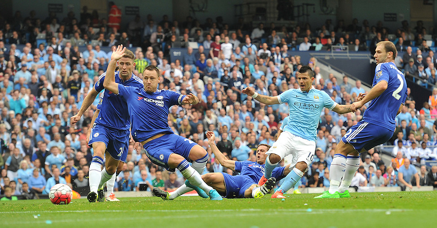 GOAL - Manchester City's Sergio Aguero scores the opening goal past Chelsea's John Terry despite the attentions of Gary Cahill<br /> <br /> Photographer Dave Howarth/CameraSport<br /> <br /> Football - Barclays Premiership - Manchester City v Chelsea - Sunday 16th August 2015 - Etihad Stadium - Manchester<br /> <br /> &copy; CameraSport - 43 Linden Ave. Countesthorpe. Leicester. England. LE8 5PG - Tel: +44 (0) 116 277 4147 - admin@camerasport.com - www.camerasport.com