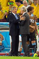 Uruguay manager Oscar Washington Tabarez shakes hands with Columbia manager Jose Pekerman