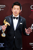 HONG KONG - MARCH 21:  South Korean Ha Jung-woo poses backstage after winning the Best Actor Award for his role at the 'The Yellow Sea' during the 5th Asia Film Awards ceremony at the Convention and Exhibition Centre on March 21, 2011 in Hong Kong, China.  Photo by Victor Fraile / studioEAST