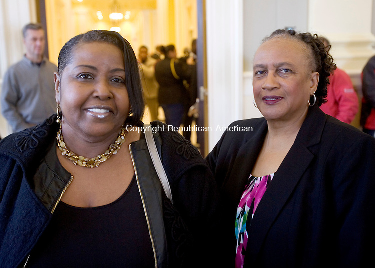WATERBURY CT. 06 February 2015-020615SV13-From left, Toni Collins and Shirley Black both of New Britain attend the Standing on the Shoulders of Giants, a Black History Month program honoring the outstanding work of African-American community leaders across central and northwest Connecticut, hosted by Rep. Elizabeth H. Esty, D-5th District at City Hall in Waterbury Friday.   <br /> Steven Valenti Republican-American