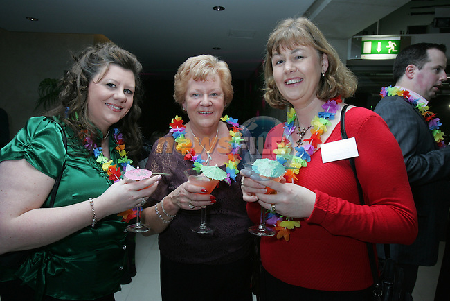 Julie Plunkett, Marian McCabe and Ann Reilly Paycheck Plus at the Drogheda Chamber D Hotel Hawaiian Tropical Night networking event..Photo: Fran Caffrey/ Newsfile.