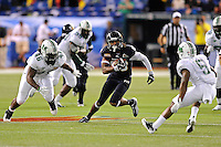 20 December 2011:  FIU wide receiver Jacob Younger (88) attempts to evade Marshall linebacker Jermaine Holmes (46) and running back Remi Watson (5) while taking a reception into the Marshall secondary in the third quarter as the Marshall University Thundering Herd defeated the FIU Golden Panthers, 20-10, to win the Beef 'O'Brady's St. Petersburg Bowl at Tropicana Field in St. Petersburg, Florida.