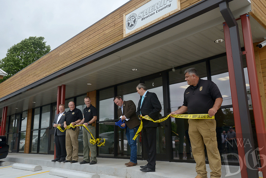 NWA Democrat-Gazette/BEN GOFF @NWABENGOFF<br /> Benton County Sheriff Shawn Holloway cuts the ceremonial ribbon Thursday, June 22, 2017, during a grand opening for the new Benton County Sheriff's Office Prairie Creek substation on Arkansas highway 12 near Beaver Lake. The new 1,500 square foot facility will have space for deputies and Arkansas Game and Fish Commission officers to work and store equipment. The sheriff's office already has substations in Siloam Springs, Gravette and Avoca.
