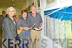 Mairead O'Sullivan Listowel, Miriam O'sullivan-Long Kilcummin and Larry O'Sullivan Templeogue admire Helen Rinchond painting 'Liminal Bondholders'  at the Gathering Art exhibition in the Department of Arts, Tourism and the Gaelteacht on Monday evening