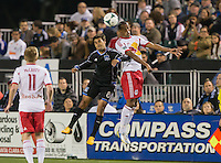 March 10th, 2013: Chris Wondolowski and Roy Miller jump for the ball during a game at Buck Shaw Stadium, Santa Clara, Ca.   Earthquakes defeated Red Bulls 2-1