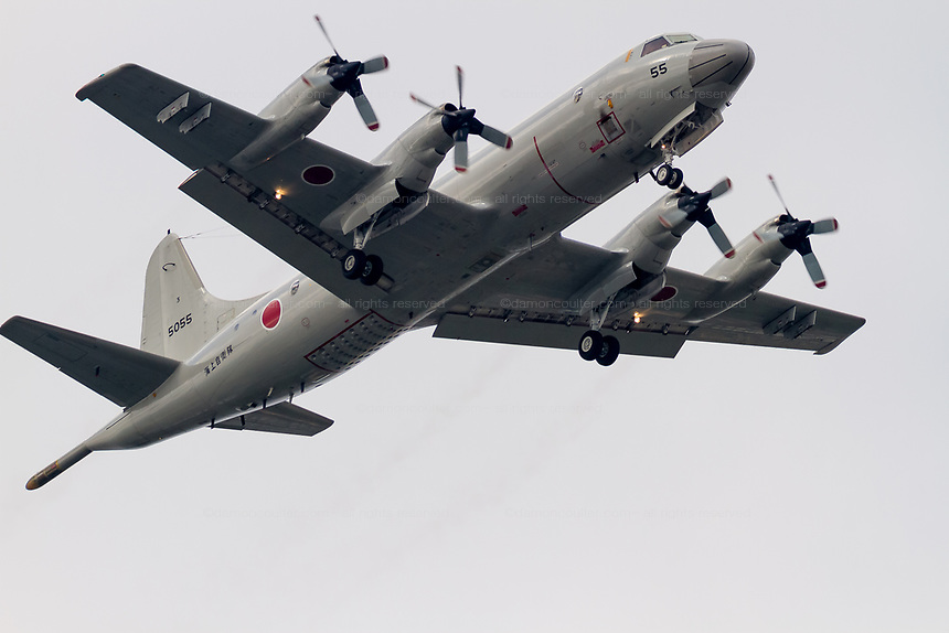 A Lockheed P-3C Orion Maritime reconnaissance aircraft flying with the Japanese Maritime Self Defence Force flies over Chou Rinkan in Kanagawa, Japan. Tuesday May 31st 2016