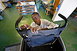 Lucky Chirambaterere adjusts a wheelchair at the National Rehabilitation Centre in Ruwa, Zimbabwe. The Centre assembles and fits wheelchairs provided by the Jairos Jiri Association with support from CBM-US.