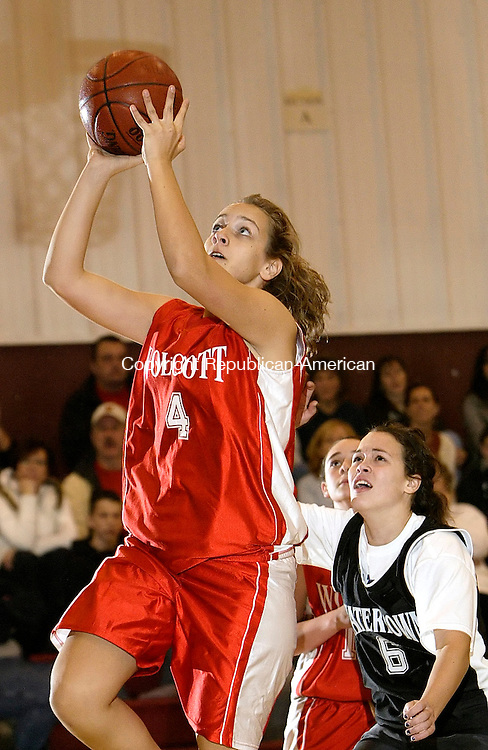 WATERBURY, CT, 11/23/08- 112308BZ06- Wolcott's Cassie Ruscz (4) goes to the hoop against Watertown's Victoria Engelhard (6) during the St. Mary's School Tip-off Tournament at the Sacred Heart High School gym Waterbury Sunday night.<br /> Jamison C. Bazinet Republican-American