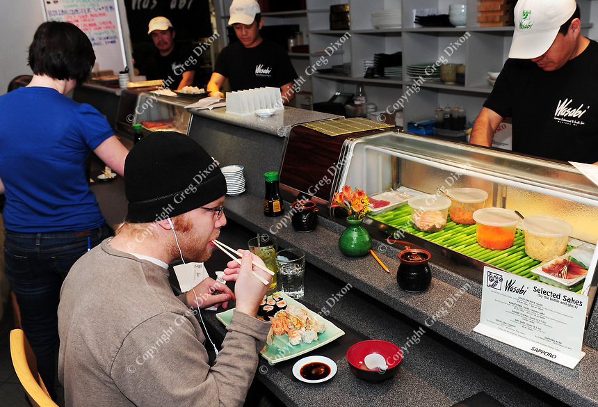 Luke Berg has dinner at the sushi bar at Wasabi Japanese Restaurant on State Street. Wasabi has a full dining room in addition to the bar.