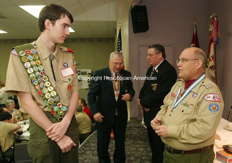 WATERBURY, CT 01/26/08- 012608BZ05- Matthew Montano, of Troop 198 in Cheshire, left, talks with G. Hall Walling, district advancement chair, before the start of the thirty first annual Eagle Scout recognition luncheon at the Waterbury Lodge of Elks #265 in Waterbury Saturday.  In the background are Walter J. Nizgorski, state commander Military Order of World Wars, and Patrick Basile, past exalted ruler of Elks Lodge #265, and past district deputy grand exalted ruler, <br /> Jamison C. Bazinet Republican-American