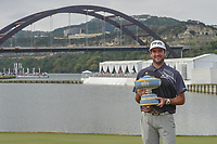 Bubba Watson (USA) holds The Walter Hagen Cup on 13 with the Loop 360 bridge in the background following day 5 of the World Golf Championships, Dell Match Play, Austin Country Club, Austin, Texas. 3/25/2018.<br /> Picture: Golffile | Ken Murray<br /> <br /> <br /> All photo usage must carry mandatory copyright credit (© Golffile | Ken Murray)