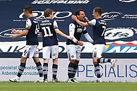 Mason Bennett of Millwall scores the first goal for his team and celebrates with his team mates during Millwall vs Swansea City, Sky Bet EFL Championship Football at The Den on 30th June 2020