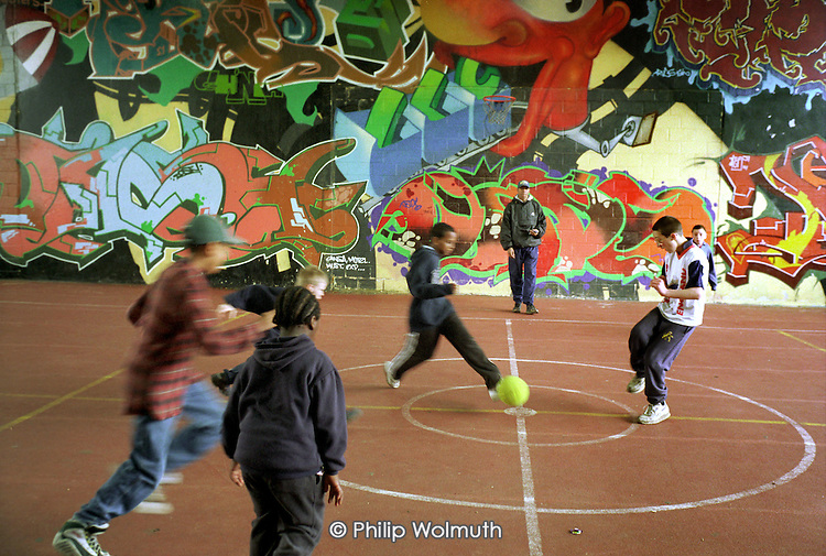 Football under the Westway at Acklam Road Playspace in West London, which caters for children with and without disabilities.