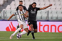 Cristiano Ronaldo of Juventus and Jason Denayer of Lyon compete for the ball during the Champions League round of 16 second leg football match between Juventus FC and Lyon at Juventus stadium in Turin (Italy), August 7th, 2020. <br /> Photo Federico Tardito / Insidefoto