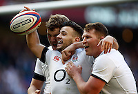 Photo: Richard Lane/Richard Lane Photography. England v Wales. RBS Six Nations. 09/03/2014. England's Danny Care celebrates his try with Joe Launchbury and Dylan Hartley.