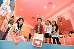 Young visitors play a Hello Kitty craps dice game at the opening of Hello Kitty's Kawaii (Cute) Paradise, a Hello Kitty theme store, in Tokyo, Japan on Thursday 21 October  2010. .Photographer: Robert Gilhooly