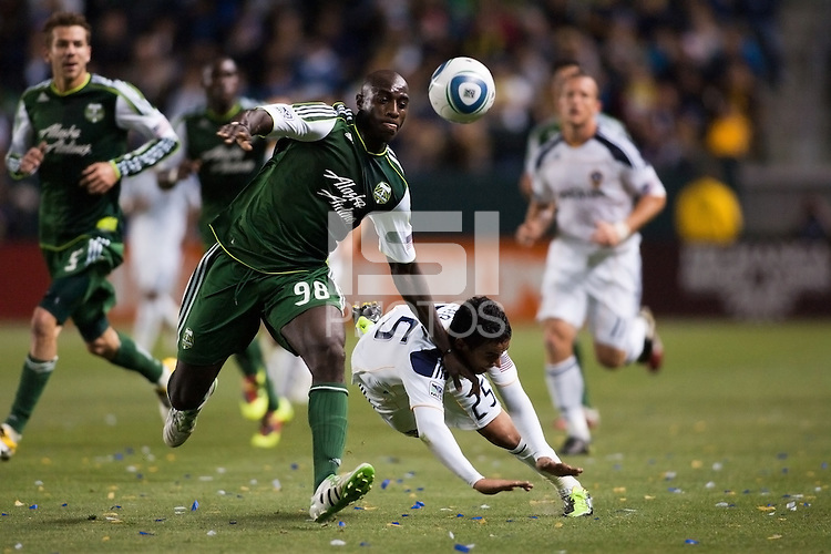 Portland Timbers defender Mamadou Danso (98) blows past Miguel Lopez (25) of the LA Galaxy chasing down a loose ball.The LA Galaxy defeated the Portland Timbers 3-0 at Home Depot Center stadium in Carson, California on  April  23, 2011....