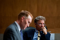 """United States Senator James Lankford (Republican of Oklahoma), left, and US Senator Rand Paul (Republican of Kentucky) right, prepare for a US Senate Homeland Security and Governmental Affairs business meeting to consider a motion to authorize the Chairman to issue notices for taking depositions, subpoenas for records, and subpoenas for testimony, to individuals relating to the Federal Bureau of Investigation's Crossfire Hurricane Investigation; the DOJ Inspector General's review of that investigation; and the """"unmasking"""" of U.S. persons affiliated with the Trump campaign, transition team, and Trump administration, as described in Schedule A (Items 1-3), and the nominations of John Gibbs, of Michigan, to be Director of the Office of Personnel Management, and John M. Barger, of California, Christopher Bancroft Burnham, of Connecticut, and Frank Dunlevy, of California, each to be a Member of the Federal Retirement Thrift Investment Board.in the Dirksen Senate Office Building on Capitol Hill in Washington, DC., Wednesday, September 16, 2020. <br /> Credit: Rod Lamkey / CNP /MediaPunch"""