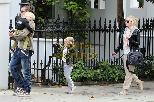GAVIN ROSSDALE, ZUMA ROSSDALE, KINGSTON ROSSDALE, GWEN STEFANI.the Stefani-Rossdale family out and about in London, England, UK, .May 7th 2011..full length mother son child sunglasses cream beige trousers red white scarf black bag leather jacket dad husband father wife kids children jeans green .CAP/HIL.©John Hillcoat/Capital Pictures.