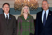 Sir Paul McCartney, left, and his girlfriend, Heather Mills, center, pose for a photo following their meeting with United States Secretary of State Colin Powell, right, at the Department of State on April 19, 2001 on the subject of land mines. .Credit: Ron Sachs / CNP