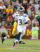 Seattle Seahawks quarterback Russell Wilson (3) scrambles in the third quarter of the game against the Washington Redskins at FedEx Field in Landover, Maryland on Monday, October 6, 2014.  The Seahawks won the game 27 - 17.<br /> Credit: Ron Sachs / CNP