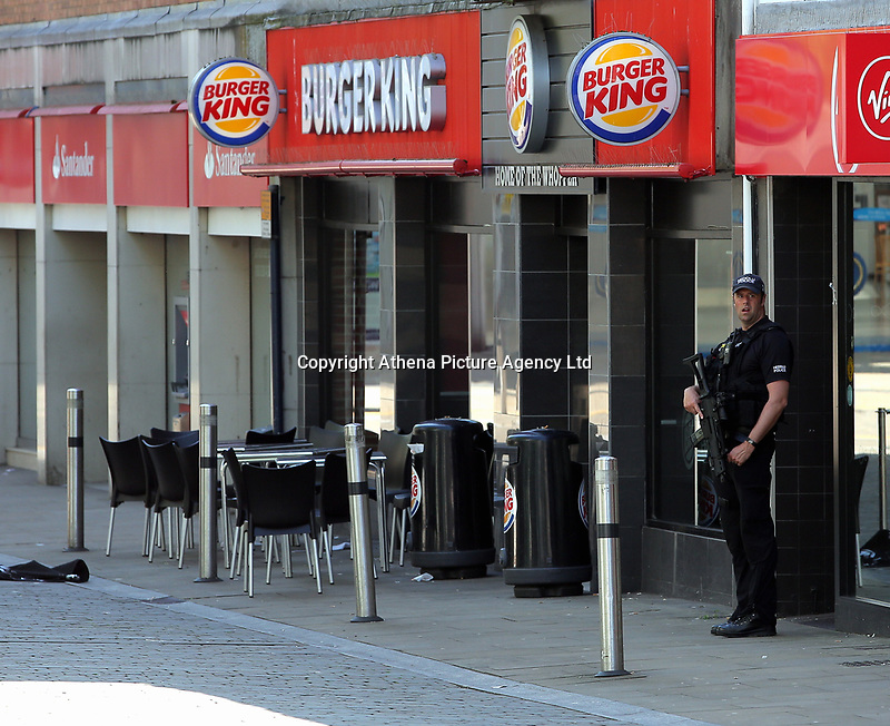 Pictured: An armed police officer in Union Street in Swansea  Wednesday 24 May 2017<br /> Re: The Quadrant shopping centre in Swansea has been evacuated following reports of a suspicious package being found.<br /> The bus station and Swansea Indoor Market have also been closed as part of the evacuation.