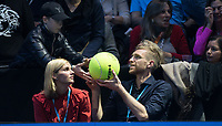 Arsenal & German footballer Per Mertesacker signs a tennis ball for a spectator during the 2nd semi final match at the ATP World Tennis  the O2, London, England on 18 November 2017. Photo by Andy Rowland.