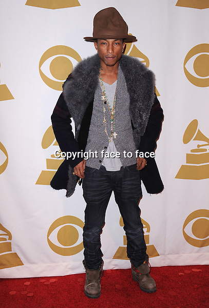 LOS ANGELES, CA - JANUARY 27:  Pharrell Williams arrives at &quot;The Night That Changed America: A Grammy Salute to The Beatles&quot; at the Los Angeles Convention Center West Hall on January 27, 2014 in Los Angeles, California. <br />
