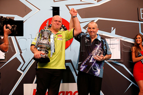24.07.2016. Empress Ballroom, Blackpool, England. BetVictor World Matchplay Darts. Michael van Gerwen and Phil Taylor celebrate their final