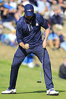 Webb Simpson (Team USA) sinks his putt on the 9th green during Saturday's Foursomes Matches at the 2018 Ryder Cup 2018, Le Golf National, Ile-de-France, France. 29/09/2018.<br /> Picture Eoin Clarke / Golffile.ie<br /> <br /> All photo usage must carry mandatory copyright credit (&copy; Golffile | Eoin Clarke)