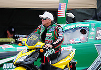 Feb. 11, 2012; Pomona, CA, USA; NHRA funny car driver John Force during qualifying for the Winternationals at Auto Club Raceway at Pomona. Mandatory Credit: Mark J. Rebilas-