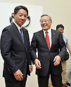 May 9, 2013, Tokyo, Japan - Outgoing President Takashi Yamanouchi, right, of Japan's Mazda Motor Corp., laughs as he poses with his successor, Masamichi Kogai, production and purchasing specialist of the automaker following a news conference in Tokyo on Thursday, May 9,m 2013. (Photo by Natsuki Sakai/AFLO)